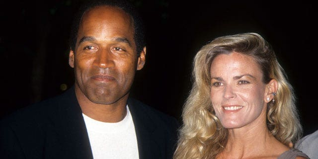 """LOS ANGELES - MARCH 16:  O.J. Simpson and Nicole Brown Simpson pose at the premiere of the """"Naked Gun 33 1/3: The Final Isult"""" in which O.J. starred on March 16, 1994 in Los Angeles, California.  (Photo by Vinnie Zuffante/Archive Photos/Getty Images)"""