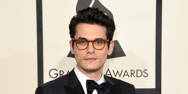 John Mayer discusses his struggle with fame early on in his career.