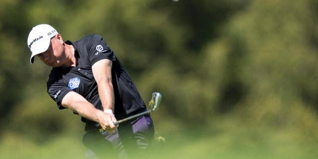 Graeme Storm of England in action at hole 12 during the third round of the Omega European Masters Golf Tournament in Crans-Montana, Switzerland, Saturday, Sept. 6, 2014. (AP Photo/Keystone/Ennio Leanza)