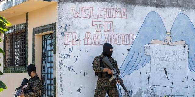 FILE - In this Aug. 31, 2015 file photo, soldiers guard a corner in a gang-controlled neighborhood in Ilopango, El Salvador. A video broadcast by local media on Saturday, March 26, 2016, purportedly made by the country's main street gangs, is offering an end to killings, and asks the government not to continue an anti-gang offensive. Officials said they would not negotiate with the gangs. (AP Photo/Salvador Melendez, File)