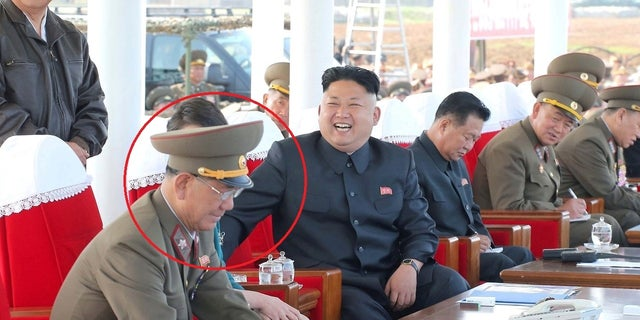 Kim Jong Un, right, and Hwang Pyong-so enjoy watching an air show in 2014.