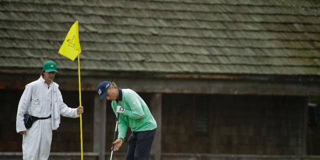 Bernhard Langer, of Germany, putts on the 11th green during a practice round for the Masters golf tournament Tuesday, April 8, 2014, in Augusta, Ga. (AP Photo/Chris Carlson)