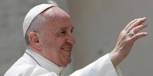 Pope Francis salutes at the end of his weekly general audience in St. Peter square at the Vatican, Wednesday, April 26, 2017. (AP Photo/Andrew Medichini)