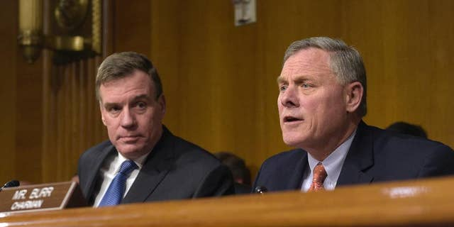 Senate Intelligence Committee Chairman. Sen. Richard Burr, R-N.C., right, joined by Vice Chairman Sen. Mark Warner, D-Va., left, at a Senate Intelligence Committee hearing on Capitol Hill in Washington, Thursday, March 30, 2017. (AP Photo/Susan Walsh)