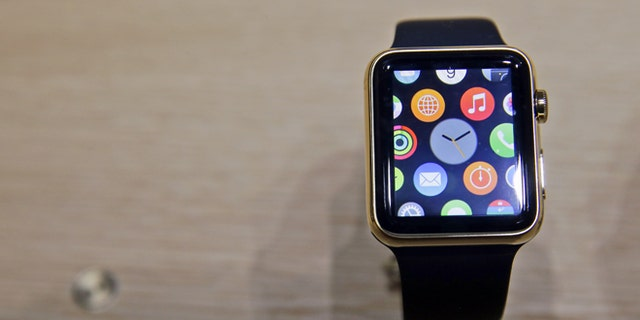 A variety of the Apple Watch is on display in the demo room after an Apple event on Monday, March 9, 2015, in San Francisco. Pre-orders for the Apple Watch start April 10. The device costs $349 for a base model, while a luxury gold version will go for $10,000.