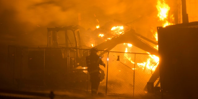 April 27, 2015: Firefighters battle a blaze after rioters plunged part of Baltimore into chaos, torching a pharmacy, setting police cars ablaze and throwing bricks at officers.