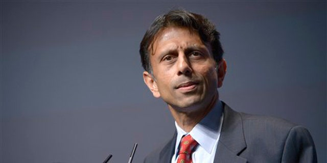 FILE -- Aug. 30, 2013: Louisiana Gov. Bobby Jindal speaks at the Americans for Prosperity Foundation's Defending the American Dream Summit in Orlando. Jindal on Wednesday, Sept. 18, 2013. demanded that federal officials abandon their challenge of his state's voucher system, accusing the Justice Department of being more interested in doing favors for teacher unions than helping students.