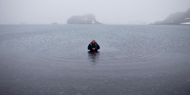 FILE -- Jan. 21, 2015: Scuba diver Luis Torres tests the water at Chilean scientific station Escudero at Villa Las Estrellas, in King George Island, in the South Shetland Islands archipelago of Antarctica.