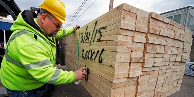 March 31, 2015: Roy Livesey marks a pallet of 2x4's at the Allegheny Millwork and Lumberyard in Pittsburgh. The Commerce Department releases first-quarter gross domestic product on Wednesday, April 29, 2015.
