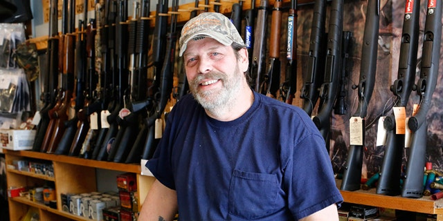 FILE -- March 31, 2015: Shooter's Paradise owner Paul Barrett stands inside his store in Sioux City, Iowa.