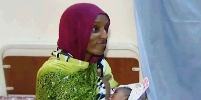 June 5, 2014: In this file image made from an undated video provided by Al Fajer, a Sudanese nongovernmental organization, Meriam Ibrahim breastfeeds her newborn baby girl as the NGO visits her in a room at a prison in Khartoum, Sudan. (AP)