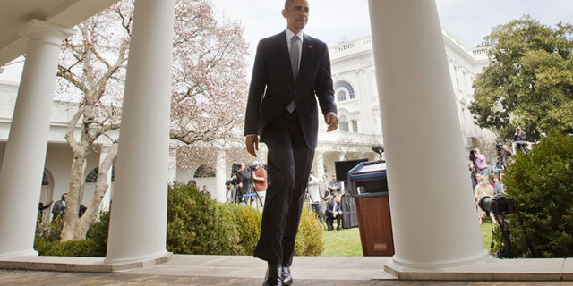 April 2, 2015: President Obama walks back to Oval Office from the Rose Garden of the White House in Washington.
