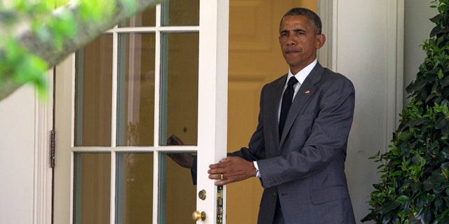 April 29, 2015: President Obama walks out of the Oval Office of the White House in Washington to board Marine One on the South Lawn for a trip to Walter Reed National Military Medical Center to meet with wounded veterans.