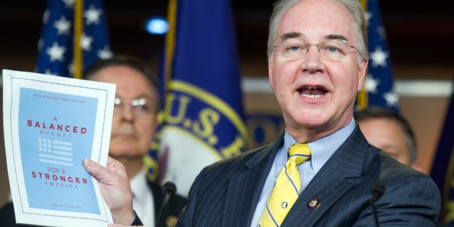 March 17, 2015: House Budget Committee Chairman Rep. Tom Price, R-Ga. holds-up a synopsis of the House Republican budget proposal as he announces the plan on Capitol Hill in Washington. The plan includes a boost in defense spending but cuts in the Medicaid program for the poor, food stamps and health care subsidies.