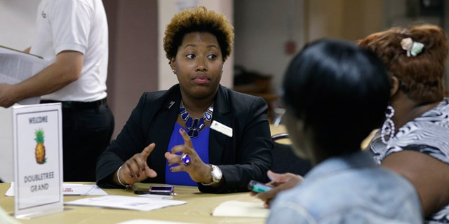 Jan. 23, 2015: Natalie Parker, director of human resources at the Doubletree Grand, left, talks with job applicants during a job fair at the Hospitality Institute.