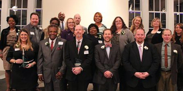 Kelly Hahn, pictured top row, third from right, a St. Louis Public Schools Teacher of the Year, says she has been fired on charges of child neglect and endangerment over an incident involving a pull-up diaper. (St. Louis Public Schools)
