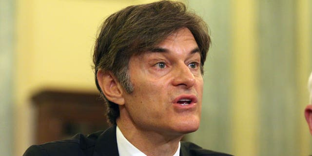 """In this June 17, 2014, file photo, Dr. Mehmet Oz, vice chairman and professor of surgery, Columbia University College of Physicians and Surgeons, testifies on Capitol Hill in Washington. Ten top physicians want Columbia University to remove the celebrity doctor from his medical faculty position. They cite what they call the heart surgeon's """"egregious lack of integrity"""" as host of a television program where he promotes weight loss products."""