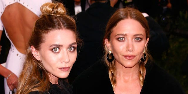 Ashley Olsen (left) with her twin sister, Mary-Kate (right)