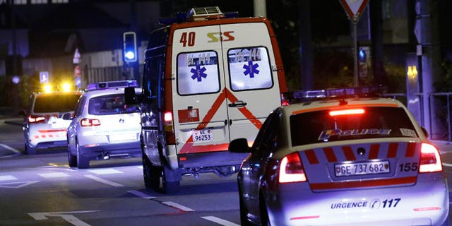 An ambulance (2R) carrying Cuban doctor Felix Baez leaves Cointrin airport in Geneva November 21, 2014. A Cuban doctor, identified by Cuban officials as Felix Baez, who was infected with Ebola in Sierra Leone, was flown to Switzerland for treatment at the University Hospital in Geneva (HUG). Baez is one of 165 Cuban doctors and nurses treating Ebola patients in Sierra Leone and is the first of the group, deployed since early October, who is known to be infected by the virus that has killed more than 5,400 people.