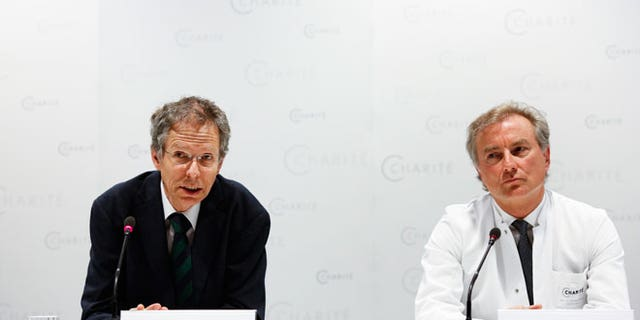 Christoph Buehrer, left, director of neonatology at Charite Hospital and Wolfgang Henrich, director of gynecology at Charite Hospital, brief the media about the situation of a 65-year old mother Annegret Raunigk and her quadruplets, in Berlin, Germany, Wednesday, May 27, 2015. Doctors say the quadruplets born prematurely to a 65-year-old Berlin woman are still in intensive care, but have been gaining a little weight and are being given their mother's milk through feeding tubes.