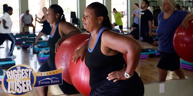 """Guest Stacey Scott works out with a stability ball in a """"total toning"""" class at the Biggest Loser Resort in Ivins, Utah September 7, 2010. Guests at the resort affiliated with the popular reality television show eat about 1,200 calories a day but burn over 2,000 exercising 6 - 7 hours daily."""