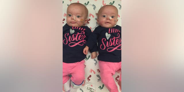 Kenedi and Kendal Breyfogle, 3-month-old identical twin girls from Pierre, South Dakota, are undergoing chemotherapy at the Mayo Clinic in Rochester, Minnesota, to treat acute myeloid leukemia (AML), a cancer that usually affects older adults.