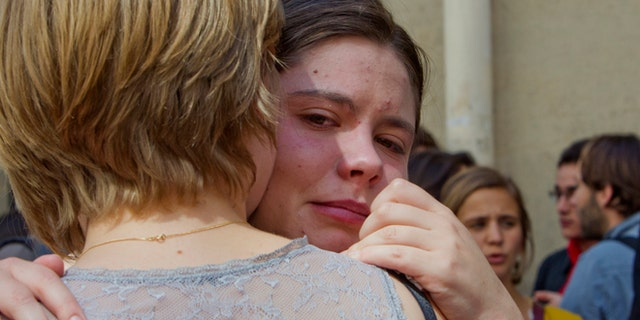 June 6, 2013: Unidentified students react  in front of the Institut d'etudes Politiques, also known as Sciences Po.