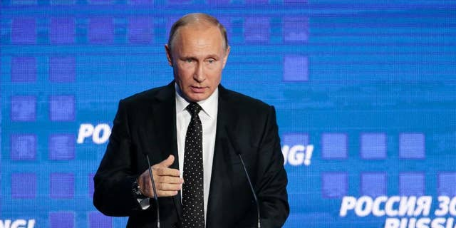 """Russian President Vladimir Putin gestures while speaking at the 8th annual VTB Capital """"Russia Calling!"""" Investment Forum in in Moscow, Russia, Wednesday, Oct. 12, 2016.Russia's economy has been on its way down since it slipped into recession at the start of last year. (AP Photo/Ivan Sekretarev)"""