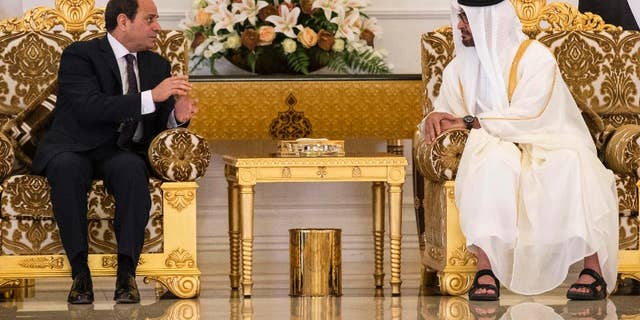 In this photo released by the Emirates News Agency, WAM, Egyptian President Abdel-Fattah El-Sissi, left, meets with the Crown Prince of Abu Dhabi and Deputy Supreme Commander of the UAE Armed Forces Sheikh Mohammed bin Zayed al-Nahayan, in Abu Dhabi, United Arab Emirates, Wednesday, May 3, 2017. (Ryan Carter/Crown Prince Court - Abu Dhabi, via AP)
