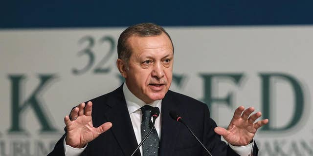 """Turkey's President Recep Tayyip Erdogan addresses an annual economy and trade meeting of the Organization for Islamic Cooperation in Istanbul, Wednesday, Nov. 23, 2016. Erdogan declared Wednesday that an upcoming vote in the European Parliament on whether to freeze membership talks with Turkey is of """"no value"""" to his country.(Yasin Bulbul, Presidential Press Service/Pool Photo via AP)"""