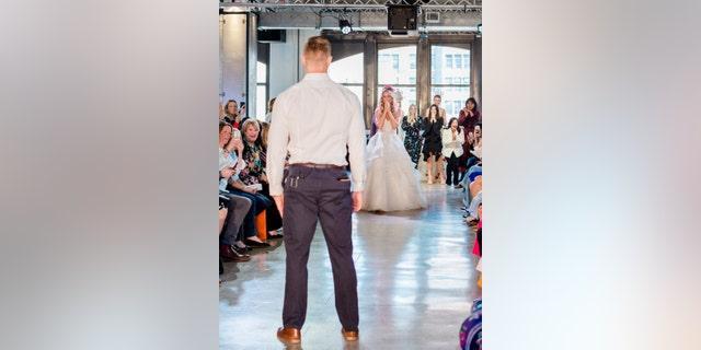 Nicole Kaspar was shocked to find boyfriend Chris Stapleton at the end of the runway.