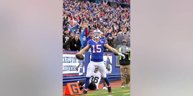 Buffalo Bills wide receiver Chris Hogan celebrates after scoring a touchdown against the Cleveland Browns during the second half of an NFL football game, Sunday, Nov. 30, 2014, in Orchard Park, N.Y. (AP Photo/Bill Wippert)