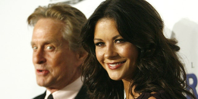"Michael Douglas, left, and wife Catherine Zeta-Jones, right, are completely on board with working together now that they're ""pretty much empty-nesters."""
