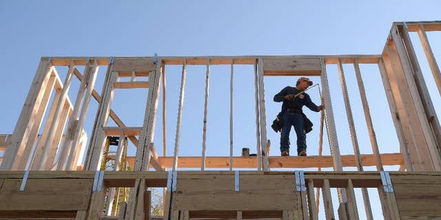 FILE - In this Feb. 13, 2015 file photo, Construction worker David Rager, 53, frames a window in the upper floor of a two-story custom home being built in Orlando, Fla. The Commerce Department releases construction spending for February on Wednesday, April 1, 2015. (AP Photo/Phelan M. Ebenhack, File)