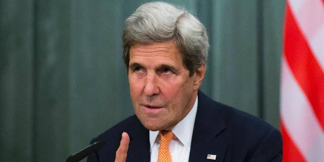 U.S. Secretary of State John Kerry gestures while speaking to the media during his and Russian Foreign Minister Sergey Lavrov news conference following their long talks in Moscow, Russia, Friday, July 15, 2016. Lavrov and other Russian officials have called on their countrymen in Turkey to stay indoors amid uncertainty about whether a military coup is taking place. Lavrov made the statement early Saturday at a news conference with U.S. Secretary of State John Kerry. (AP Photo/Alexander Zemlianichenko)