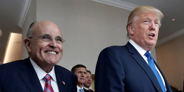 Rudy Giuliani, shown here with President Trump in September 2016, is joining his legal team.