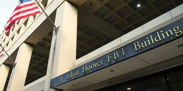 FILE - In this Nov. 2, 2016, file photo, the FBI's J. Edgar Hoover headquarter building in Washington. New documents show the FBI scrambling to respond to Hillary Clinton's lawyers in 2016. (AP Photo/Cliff Owen, File)