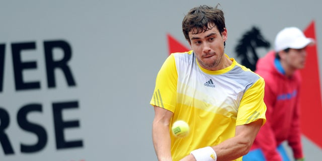 Argentine's Guido Pella returns a shot to Serbia's Janko Tipsarevic during their tennis match at the Power Horse Cup in Duesseldorf, Germany, Wednesday, May 22, 2013. Pella, a qualifier, defeated top seeded Tipsarevic with 7-6 and 6-1. (AP Photo/dpa, Caroline Seidel)