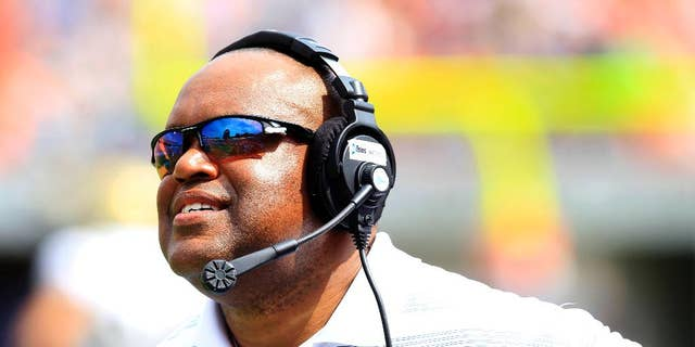 Virginia head coach Mike London up during the second half of an NCAA college football game against UCLA at Scott Stadium, Saturday, Aug. 30, 2014, in Charlottesville, Va. UCLA won 28-20. (AP Photo/Andrew Shurtleff)