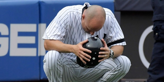 Yankees third base coach Joe Espada reacts after a young girl was hit by a foul ball on Wednesday at Yankee Stadium.