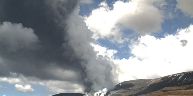 In this photo released by the Institute of Geological and Nuclear Sciences, smoke is shown billowing out of Te Maari crater on Mount Tongariro, New Zealand after a brief eruption Wednesday, Nov. 21, 2012.