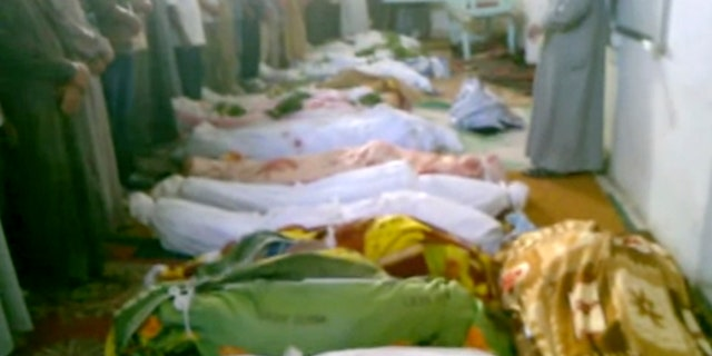 July 13, 2012: This image made from amateur video from Hama Revolution 2011 and accessed by AP video purports to show bodies of victims killed by violence that, according to anti-regime activists, was carried out by government forces in Tremseh, Syria, about nine miles northwest of the central city of Hama.