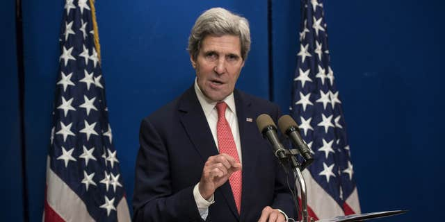 U.S. Secretary of State John Kerry speaks during a press conference at the David Citadel Hotel in Jerusalem on Sunday, Jan. 5, 2014. Kerry is heading to Jordan and Saudi Arabia to discuss his effort to broker peace between Israel and the Palestinians, yet his conversations with the U.S. allies will undoubtedly turn to other Mideast trouble spots. Kerry said Saturday that progress is being made in the Israeli-Palestinian talks, yet key hurdles are yet to be overcome. (AP Photo/Brendan Smialowski, Pool)