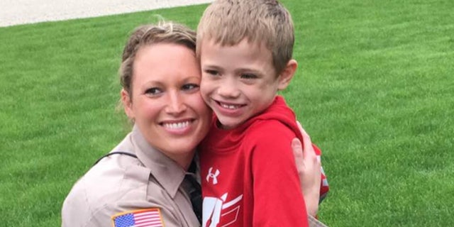 Officer Lindsey Bittorf, left, did not know Jackson, right, before volunteering to give him a kidney.