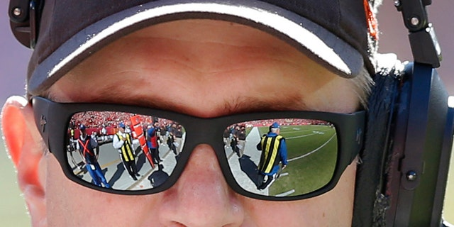 ADVANCE FOR WEEKEND EDITIONS, NOV. 9-10 - FILE - In this Oct. 27, 2013 file photo, Cleveland Browns coach Rob Chudzinski walks the sideline during the first half of an NFL football game against the Kansas City Chief in Kansas City, Mo. The Browns hit the bye week in better shape than they've been in years, and Chudzinski deserves much of the credit. (AP Photo/Ed Zurga, File)