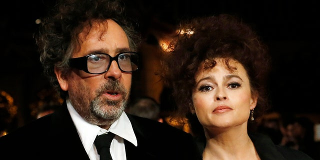 """Film director Tim Burton and actress Helena Bonham Carter arrive for the European premiere of his film """"Frankenweenie 3D"""" on October 10, 2012 at the Odeon Leicester Square in central London."""