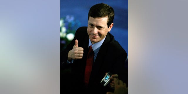 FILE - In this Jan. 18, 2006 file photograph, Israeli  Isaac Herzog, a former cabinet minister, gestures after the primary results were announced during a convention in the community of Beit Berl in central Israel. Veteran lawmaker Herzog has unseated the incumbent Labor Party leader Shelly Yachimovich on Friday, Nov. 22, 2013, and will become Israel's new opposition leader. (AP Photo/Ariel Schalit, File)