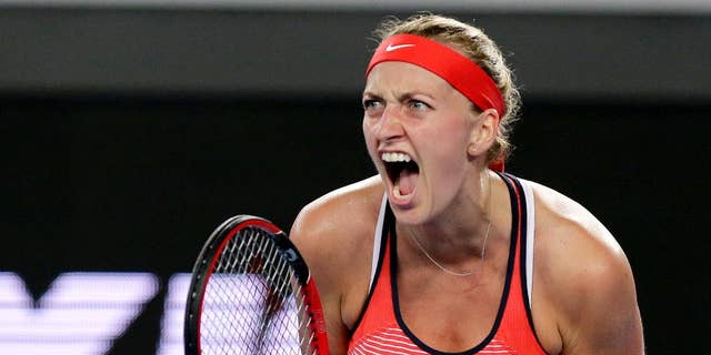 This is a Wednesday, Jan. 20, 2016 file photo of Petra Kvitova of the Czech Republic, clenches her left hand as she reacts after winning a point against Daria Gavrilova of Australia during their second round match at the Australian Open tennis championships in Melbourne, Australia.