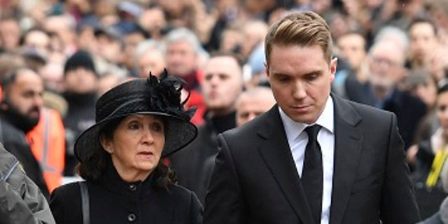 Stephen Hawking's first wife, Jane, and their son Timothy, attend the famed physicist's funeral.
