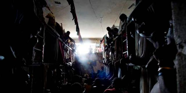 Prisoners rest in makeshift hammocks inside the National Penitentiary in downtown Port-au-Prince, Haiti.